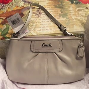 Authentic coach clutch wristlet. Lovely Ivory